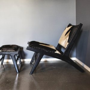 marlboro layback chair and footstool u2013 black and white cowhide